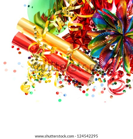 colorful garlands, streamer, cracker, party hats and confetti. festive decoration background - stock photo