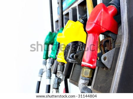 Colorful gas nozzles close up over white background - stock photo
