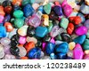 Colorful gemstones on sale at a flea market in Sibiu, Romania. Multicolored background. - stock photo