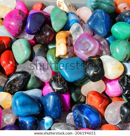 Colorful gemstones on sale at a flea market in Sibiu, Romania. Multicolored background. Square composition.