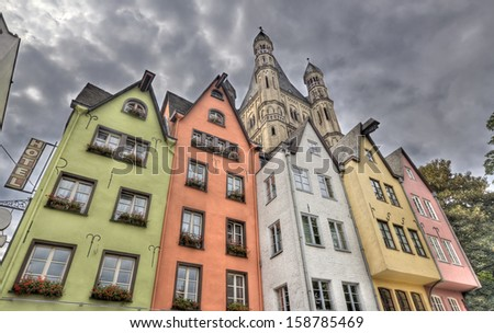 Colorful German historical houses and the tower of Great St. Martin Church in the Altstadt of Cologne, Germany - stock photo
