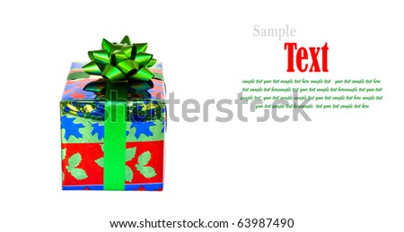 Colorful gift box decorated with green ribbon isolated on white background. - stock photo