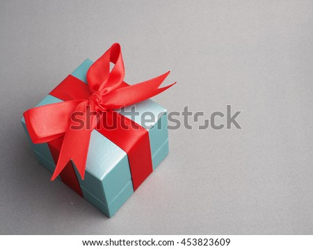 Colorful gift box in important day on gray background concept, close up.