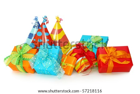 Colorful gift boxes and party hats isolated on white background - stock photo