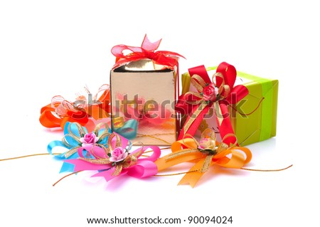 Colorful gift boxes and ribbon isolated on white background