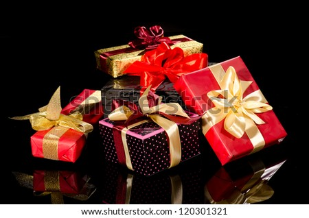 Colorful gift boxes isolated on black background - stock photo