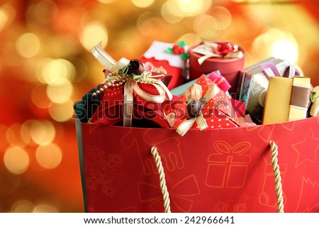 Colorful gift boxes on neon background. - stock photo