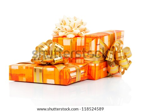 Colorful gift boxes with gold ribbon isolated on white - stock photo