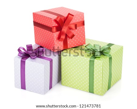 Colorful gift boxes with ribbon and bow. Isolated on white background - stock photo