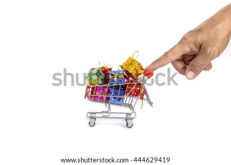 colorful gifts box in supermarket shopping cart,concept of buy shopping cart - stock photo