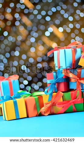 Colorful gifts close-up on a bokeh background