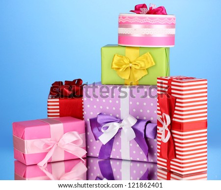 Colorful gifts on blue background - stock photo