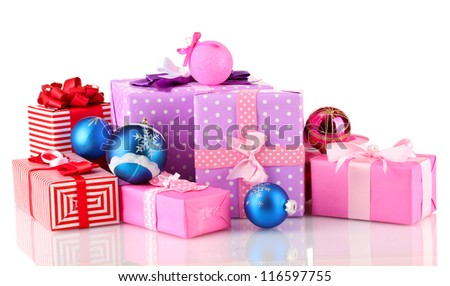 Colorful gifts with Christmas balls isolated on white - stock photo