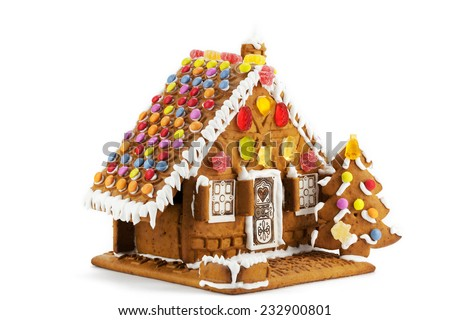 Colorful gingerbread house isolated against white background - stock photo