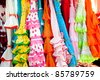 colorful gipsy flamenco dresses on rack hanged in Spain market - stock photo