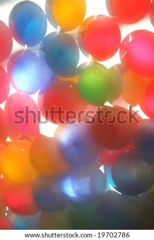 Colorful glass balls against sunlight