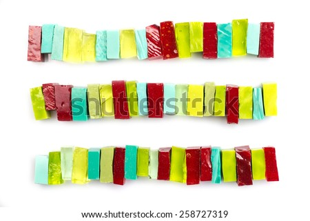 Colorful glass mosaic tiles aligned on white background