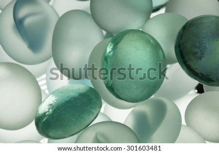 Colorful glass spheres giving an underwater bubble effect - stock photo