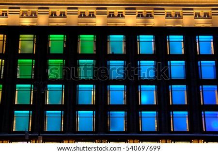 Colorful glassy facade of Kiev Central Department store (TSUM). Multicolor illuminated decorative windows. Architecture details. Colors: green, blue, yellow.