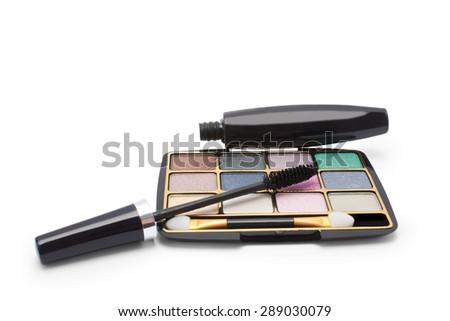 colorful, glossy eyeshadow and black mascara on a white background isolated  - stock photo