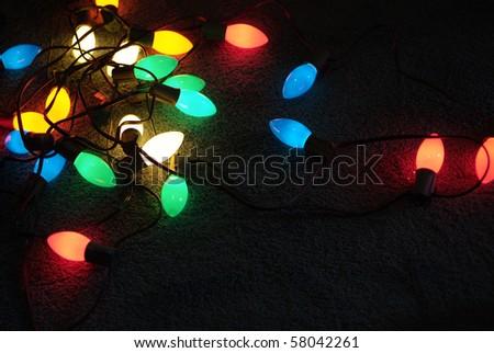 Colorful Glowing Christmas light bulbs - stock photo