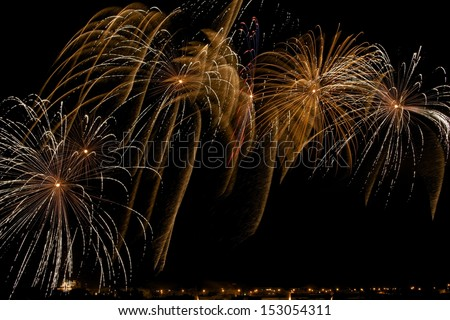 Colorful golden yellow fireworks with village silhouette in dark night background in Malta, fireworks explosion in dark sky background, Malta fireworks festival, 4 of July, explode, August 15 - stock photo