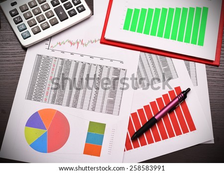 colorful graphs, charts, marketing research and business annual report - stock photo