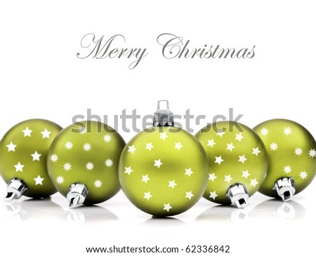 Colorful green christmas decoration baubles on white with space for text - stock photo
