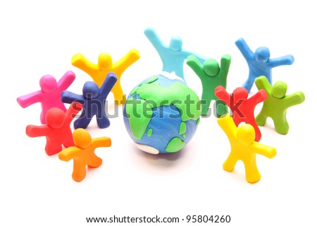colorful group of cheery plasticine people standing next to planet earth