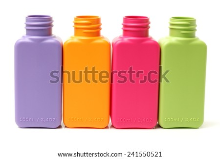 Colorful group of plastic bottles on white background - stock photo