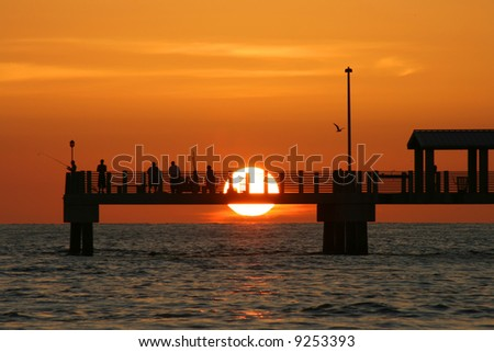 Colorful Gulf Coast Sunset. Fort De Soto Pier. Saint Petersburg Florida - stock photo