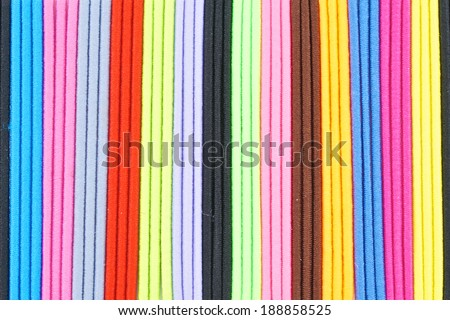 Colorful hair band made from  elastic rubber place as pattern.