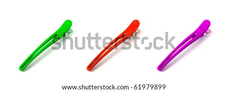 colorful hair-pins on white background - stock photo