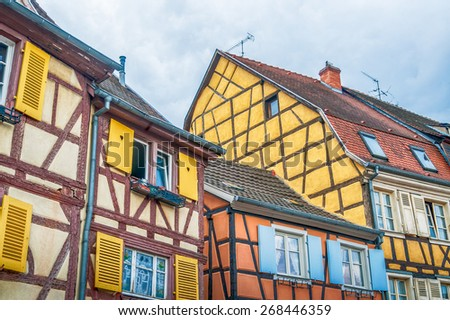 colorful half timbered houses in alsace, france - stock photo