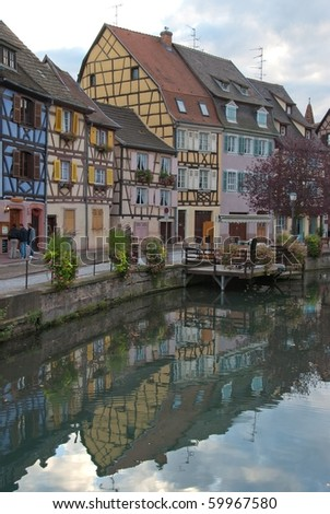 Colorful Half-timbered houses on a channel, Colmar, France - stock photo