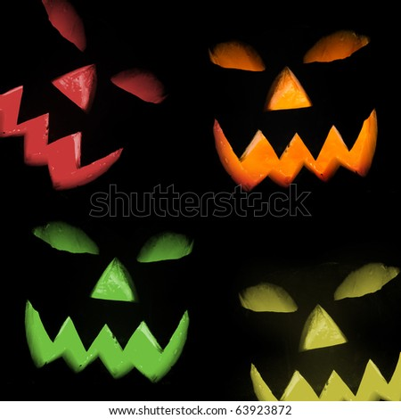 Colorful Halloween pumpkin, isolated on black background - stock photo