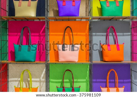 colorful hand bags on shelves - stock photo