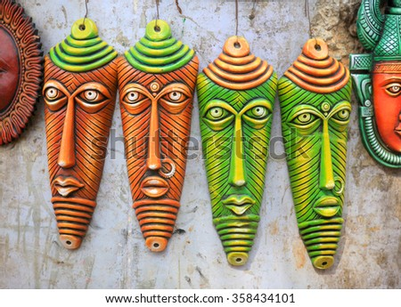 Colorful hand crafted masks of India - stock photo
