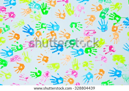 colorful hand prints on a wall