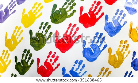 Colorful hand prints on white wall.