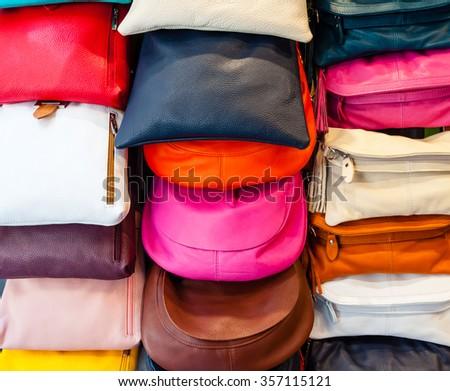 colorful handbags on display - stock photo