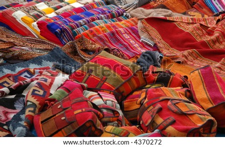 Colorful handicraft merchandise at indigenous market in Peru