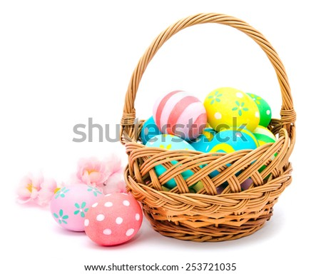 Colorful handmade easter eggs in the basket and flowers isolated on a white  - stock photo