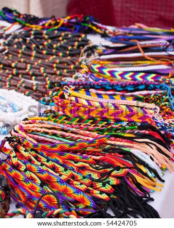 Colorful handmade jewelry for sale at the local market - stock photo