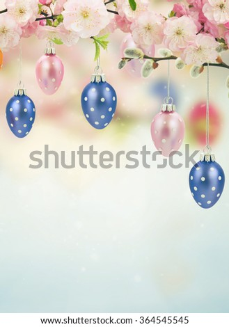 Colorful hanging easter eggs on blue