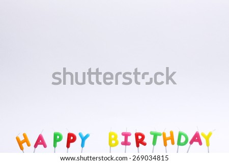 Colorful happy birthday candles on white background - stock photo