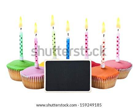 colorful happy birthday cupcakes with candles on white background - stock photo