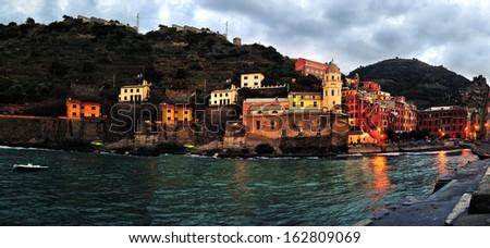 Colorful harbor at Vernazza, Cinque Terre, Italy. Aerial view of Vernazza - small italian town in the province of La Spezia, Liguria, northwestern Italy. - stock photo