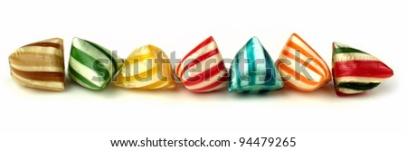 Colorful hard stripy candies banner - stock photo