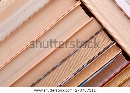 Colorful hardback and paperback books, close-up - stock photo